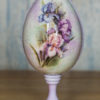 Decoupaged egg with crackles on the stand